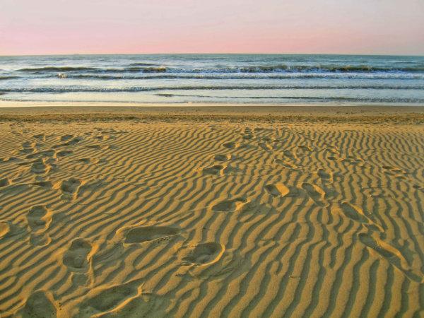 Morning empty beach and footprints on sand, Lido di Jesolo, Veneto, Italy